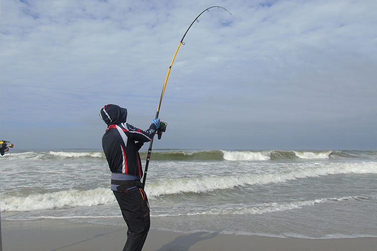 An angler bent into a large fish