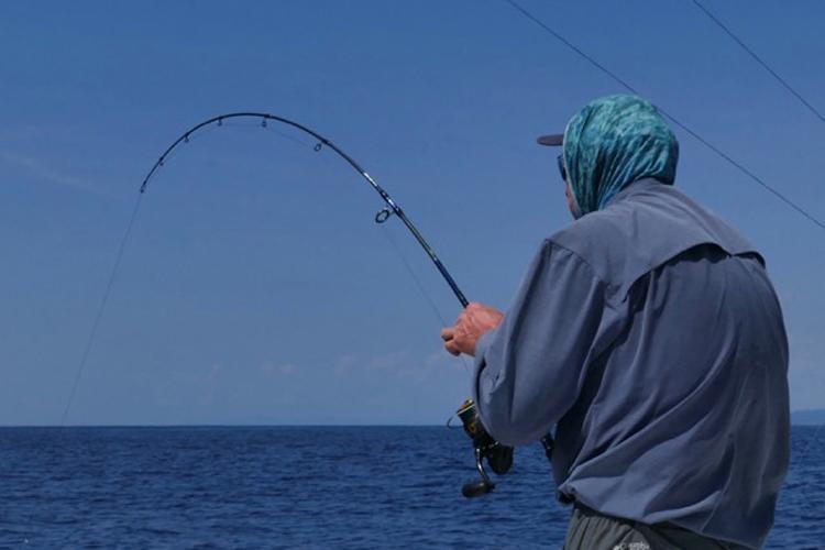 Angler bent into a fish