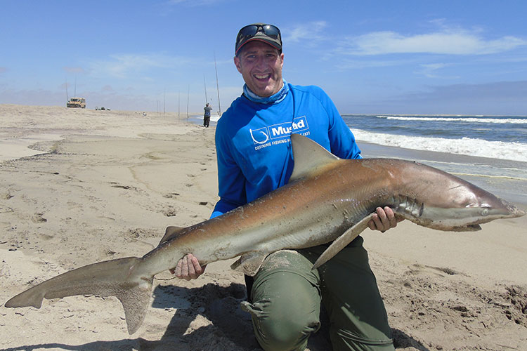 Angler with a Bronze Whaler Shark