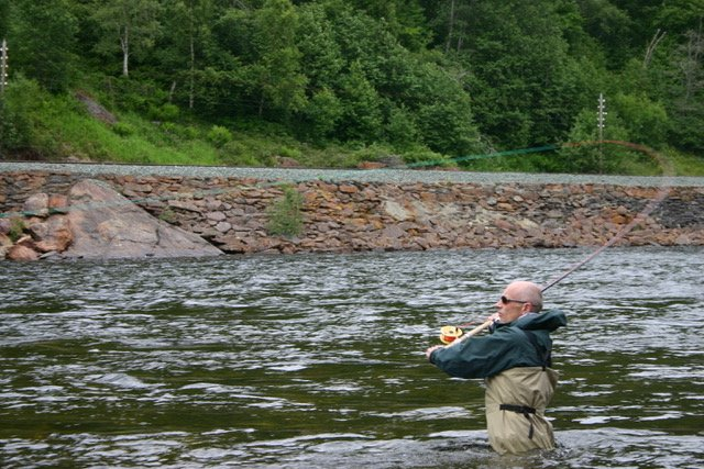 casting while wading for salmon